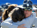 Third Place | Photo StoryBrad Coville, The Wilson TimesA North Carolina Highway Patrolman hugs an unidentified woman after the funeral for slain Trooper Bobby Gene DeMuth Wednesday, September 12, 2012 in Rocky Mount.