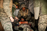 First Place | Multiple PhotosAndrew Craft, The Fayetteville ObserverMedical personnel attend to Spc. Kristin Deverson, who is playing the part of a wounded soldier, in Freedom Village during a mass casualty exercise.