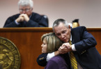 Third Place | General NewsJerry Wolford, News & RecordExpert witness Dave F. Cloutier (right) was called to demonstrate the Lateral Vascular Neck Restraint (sleeper hold) with Nancy Cloutier (seated) in front of the bench so that the defense could demonstrate the {quote}sleeper hold{quote} to the jury. Defendant Scott Simpson says he used the {quote}sleeper hold{quote} on his wife in his defense during a struggle. Defense attorney Locke Clifford maintains that his client acted in self-defense after his wife attacked him and that her death was accidental. The trial of 43-year-old Winfred Scott Simpson. He is accused of killing his 42-year-old wife, Retha Crook Simpson in March 2010, dismembering and burning her body, and dumping the remains in the woods.++++This is a surprising image, one that is very storytelling. Good work.