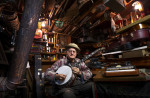 First Place | PortraitJerry Wolford, News & RecordBluegrass and country music instrument luthier (repairs musical instruments), Colon Harold Chriscoe, plays his tenor banjo in his backyard shop on Friday, November 29, 2012, in Seagrove, NC. Chriscoe, who was born on Oct 16, 1936, is unknown to most outside of the area, but has worked on the instruments of many famous bluegrass musicians from Nashville, such as Jim Mills, the banjo player for Ricky Skaggs and Kentucky Thunder, and many others. Chriscoe spent his day repairing and tuning the autoharp at right.+++It honestly was hard picking a winner in this category, it seemed a little weaker than it could be. When doing portraits, it's a great chance to really think about the character of a person and dig into that. Because of this, we thought this was top - at least it revealed a fair bit about who he was.
