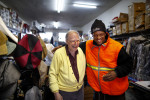 First Place | Multiple PhotosJerry Wolford, News & RecordGreensboro City employee Bryant Johnson, also a Mitchell's Shoes and Clothing customer, came in during his break while paving near the store on Friday, December 14, 2012, in Greensboro, NC.
