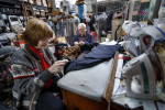 First Place | Multiple PhotosJerry Wolford, News & RecordJohn and Ellen Mitchell work on hemming pants for a customer that bought a suit on Wednesday, December 19, 2012, in Greensboro, NC.