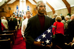 Second Place | Multiple PhotosJames Robinson, The Fayetteville ObserverWilbert Simmons carries the flag of Wolfgang Joppich followed by Robert Scarboro, out of the sanctuary at Westminster Presbyterian Church following a memorial service Friday evening.
