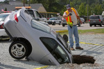 Honorable Mention | Spot NewsJulian Harrison, FreelanceEverybody wanted a picture of the car in the sink hole. When the driver pulled off Hillsborough Road into a parking lot, he had no idea that his perspective would change so completely.