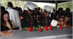 Honorable Mention | General NewsChuck Liddy, News& ObserverMourners gather around the casket of Corporal Darrion Terrell Hicks at Raleigh National Cemetery after his Interment service. Hicks died from injuries sustained from an improvised explosive device in Ghazni, Afghanistan on July 19th.