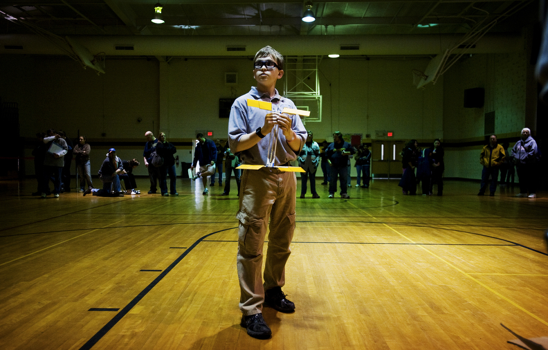 First Place | FeatureJames Robinson, Fayetteville ObserverDerek Esterly, of 71st Classical Middle School prepares to launch his helicopter while competing in the Fayetteville Regional Science Olympiad Saturday at FTCC. February 25, 2012.