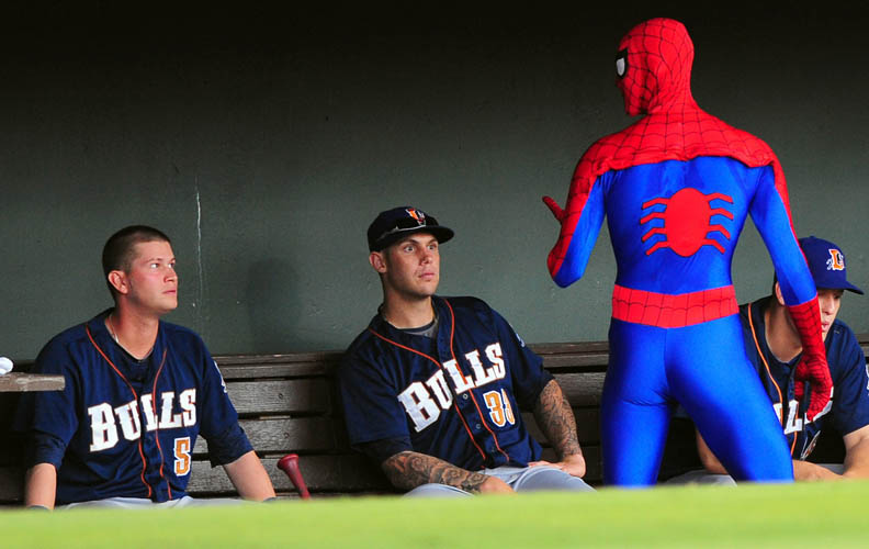 First Place | Sports FeatureJeff Siner, The Charlotte ObserverSpiderman casually walks through the Durham Bulls dugout as (5) Reid Brignac and (33) Matt Mangini look on curiously. jdsin