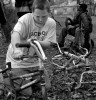 Second Place | Feature Photo StoryJerry Wolford, News-RecordKenneth Pedley, 13, grimaces as he removes handlebars from a donor bike.