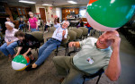 Photographer of the YearJerry Wolford, News-RecordResidents and employees at Cross Road Retirement Community play a game they call {quote}Stuck in Your Chair Volleyball.{quote} Counselor Gary Mason is drilled with a throw from WWII (Battle of the Bulge) Veteran, Ray Kirkman (center). Kirkman throws the ball so hard, the staff stack chairs behind him to keep him from flipping back in his chair.