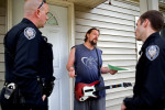 Photographer of the YearJerry Wolford, News-RecordPolice officers N.R. Ingram (left) and J.L. Matthews interrupt Thomas Nowling's Rock Guitar game as they talk to residents after a rash of crimes in the neighborhood.