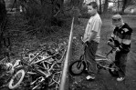 Photographer of the YearJerry Wolford, News-RecordThe boys keep a pile of junk bicycles to scavenge parts in the woods between their homes.