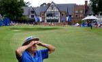 Photographer of the YearJerry Wolford, News-RecordMarshal Gary Fulk shields his eyes as he looks toward the tee on the ninth hole.