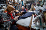 Photographer of the YearJerry Wolford, News-RecordJohn and Ellen Mitchell work on hemming pants for a customer that purchased a suit.