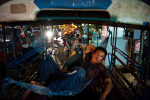 POY: Runner UpAndrew Craft, Fayetteville ObserverA tuk tuk driver lays in a hammock in the back of his tuk tuk on a hot and humid night, May 1, 2012, as he waits for fares in Vientiane, Laos.