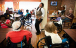 POY: Runner UpAndrew Craft, Fayetteville ObserverCountry singer Jan Pettey moves across the room as she performs Thursday, Sept. 6, 2012, for residents at Highland House, nursing home in Fayetteville, N.C.