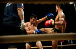 POY: Runner UpAndrew Craft, Fayetteville ObserverFighters battle it out during a Muay Lao match at a small neighborhood gym, May 5 , 2012, in Vientiane, Laos.