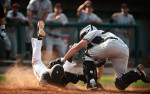 POY: Runner UpAndrew Craft, Fayetteville ObserverHarvard-Westlake's Arden Pabst tags out American Heritage's Brandon Diaz as he slides into home plate during a semifinal game at the USA Baseball H.S. Invitational in Cary, N.C.