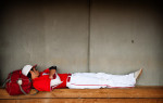 POY: Runner UpAndrew Craft, Fayetteville ObserverMater Dei's Tyler Kiehnle takes a nap in a dugout during a four-hour rain delay of the championship game at the USA Baseball H.S. Invitational in Cary, N.C.