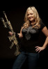 POY: Runner UpAndrew Craft, Fayetteville ObserverGun Powder Gal member Renee Muffett with her M-4 rifle.