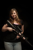 POY: Runner UpAndrew Craft, Fayetteville ObserverGun Powder Gal member Destiny Williams with her AR-15 rifle. Williams said she was at home with her husband and two small children when some people tried to break into their house. The experience encouraged her to learn how to use a weapon as a way to protect herself and her family, she said. When she learned about the Gun Powder Gals, she thought, {quote}That's got to be awesome, shooting guns with other girls.{quote}