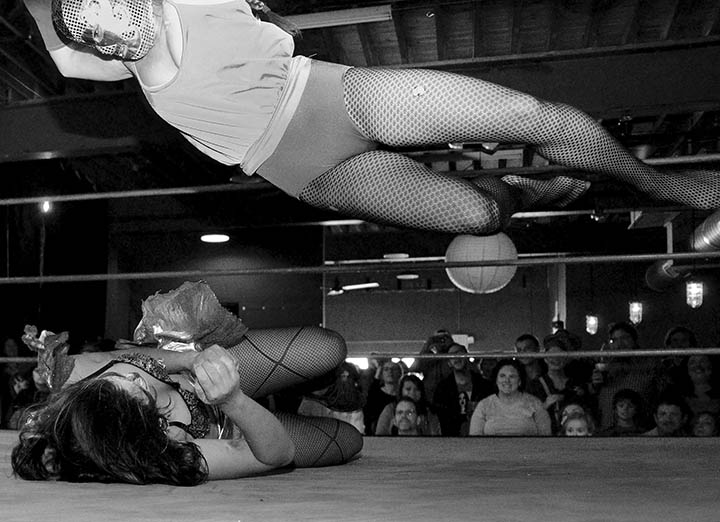 Student POY: Runner UPMelissa Melvin-RodriguezChela Tu (cq), 27, aka {quote}Juicy Buns{quote}, top, jumps on Jona Khaosanga (cq), 23, as {quote}Buenos D. Azz{quote} during Luchadoras, a female masked Mexican wrestling event, held at Motorco in downtown Durham on Saturday, November 19, 2011. All of the women, who had no prior wrestling experience, trained for three weeks with a professional wrestler.