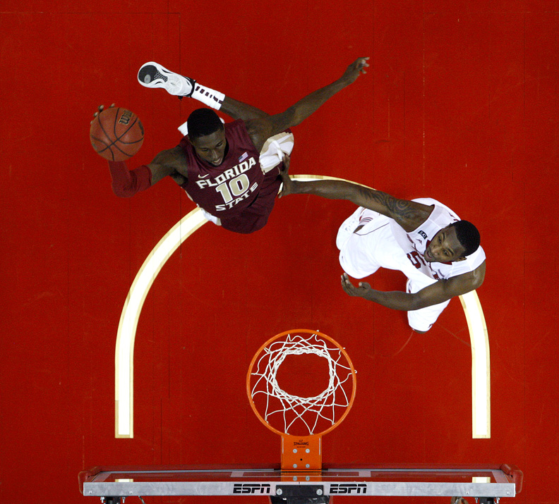 Sports Photographer of the YearEthan Hyman, News & ObserverFlorida State's Okaro White (10) goes to slam in two while defended by N.C. State's C.J. Leslie (5) in the second half during N.C. State's 76-62 loss to Florida State Saturday, February 18, 2012, at the RBC Center in Raleigh, N.C.