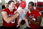 Sports Photographer of the YearEthan Hyman, News & ObserverN.C. State's R.J. Mattes (79), left, passes six-month-old Nicholas Podgurski to N.C. State's Rob Crisp (78) as Nicholas gets his picture taken with the players during Meet the Pack Day Saturday, August 11, 2012, at Carter-Finley Stadium in Raleigh, N.C.