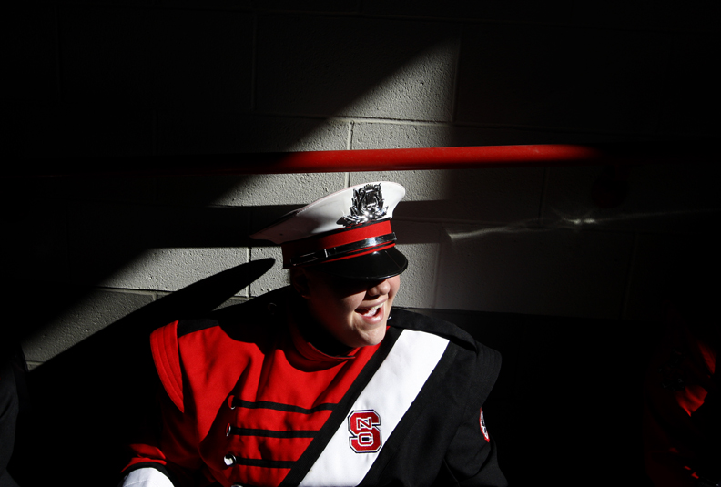 Sports Photographer of the YearEthan Hyman, News & ObserverN.C. State Marching Band member Mackenzie Coggins laughs as she waits to go onto the field before the Wolfpack's game against Virginia Saturday, November 3, 2012, at Carter-Finley Stadium in Raleigh, N.C.