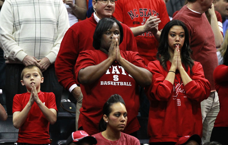 Sports Photographer of the YearEthan Hyman, News & ObserverWolfpack fans watch as N.C. State's Richard Howell (1) takes free throws late in the second half of N.C. State's 67-64 victory over Virginia  in the quarterfinals of the ACC Tournament Friday, March 9, 2012, at Philips Arena in Atlanta, GA.