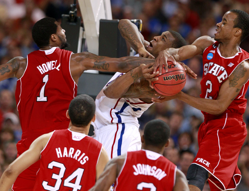 Sports Photographer of the YearEthan Hyman, News & ObserverN.C. State's Richard Howell (1), left, and N.C. State's Lorenzo Brown (2) stop the shot of Kansas's Thomas Robinson (0) during the second half of N.C. State's 60-57 loss to Kansas in the Sweet 16 round of the NCAA Men's Basketball Tournament at the Edward Jones Dome in St. Louis, Missouri.