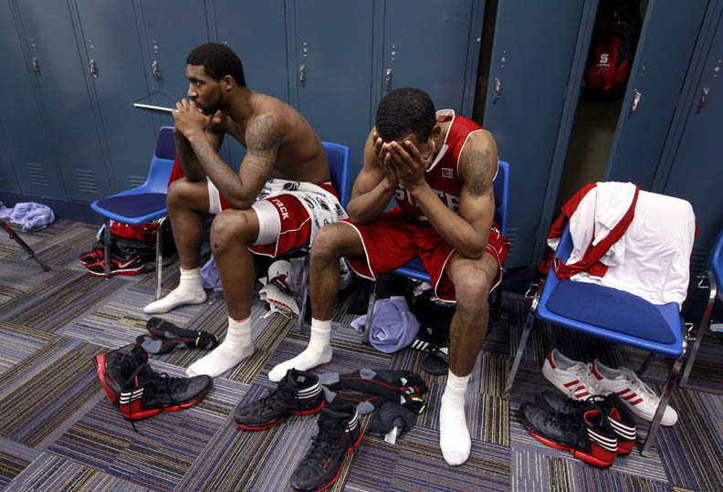 Sports Photographer of the YearEthan Hyman, News & ObserverN.C. State's Richard Howell, left, and Lorenzo Brown sit in the locker room after N.C. State's 60-57 loss to Kansas in the Sweet 16 round of the NCAA Men's Basketball Tournament at the Edward Jones Dome in St. Louis, Missouri.
