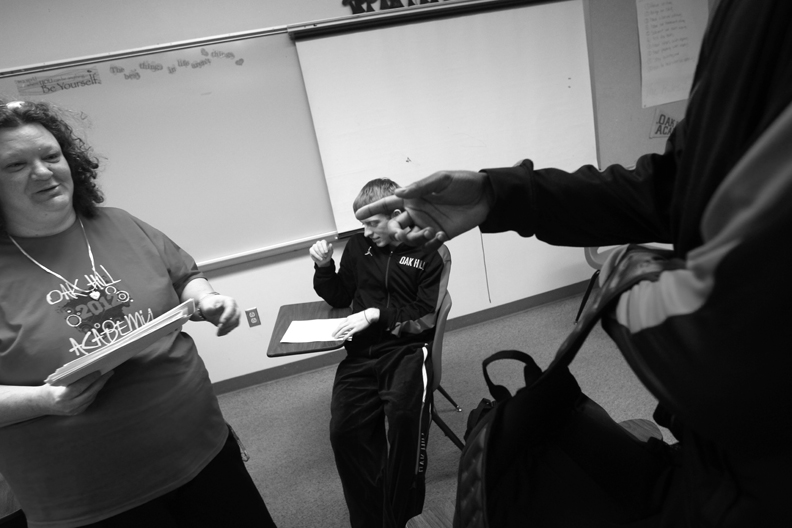 Sports Photographer of the YearEthan Hyman, News & ObserverTyler Lewis get ready in his English class at Oak Hill Academy.
