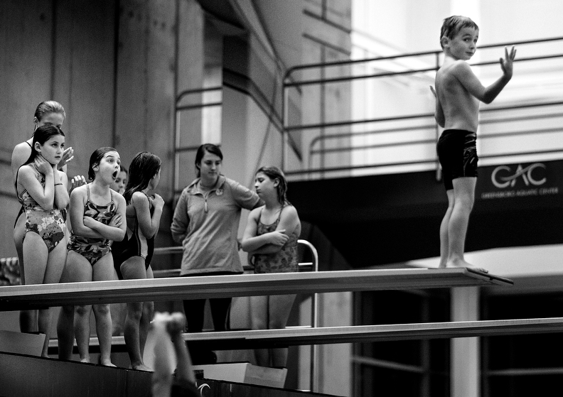 Sports POY: Runner UpJerry Wolford, News-RecordKatelyn Holland, 7, (left) screams at Josh Ladd, 7, to make his dive while he paused at the end of the diving board while working up the courage for his dive during diving lessons.