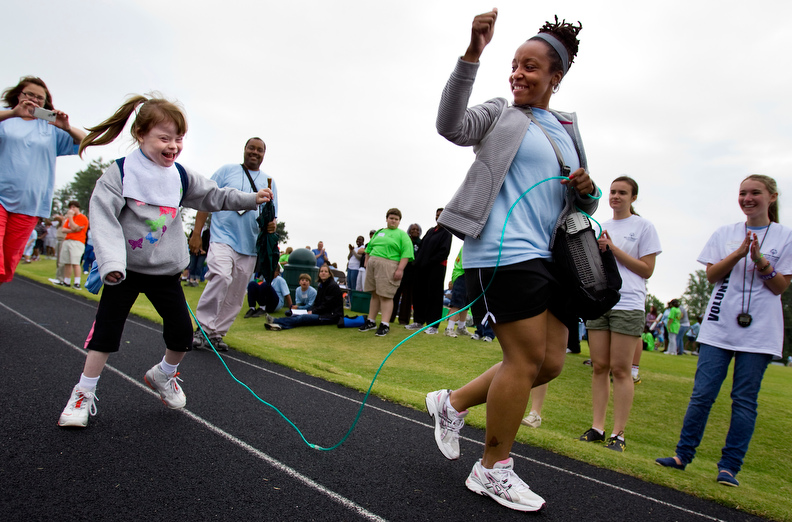 Sports POY: Runner UpJerry Wolford, News-RecordTriad Regional Special Olympic Games competitor Jenna Boyer and her speech teacher from Erwin Montessori Elementary run together during the seventh year of The Triad Regional Special Olympic Games. Jenna must stay tethered to a medical pump carried by her teacher.