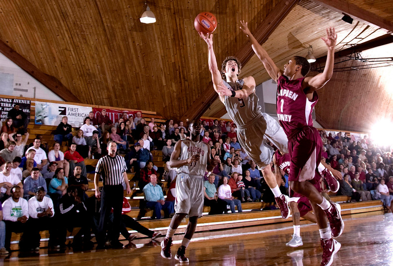 Sports POY: Runner UpJerry Wolford, News-RecordGuilford College's Gabe Lowder puts up a shot against a Hampden-Sydney defender.