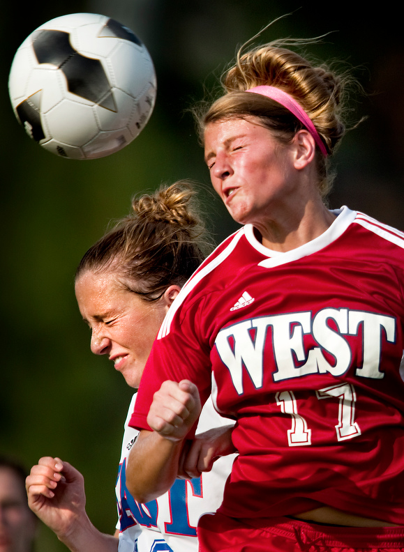 Sports POY: Runner UpJerry Wolford, News-RecordThe East's Clay Weaver and the West's Taylor Waters compete for the ball during the East West All-Star women's soccer game. The match ended in a 1-1 tie.