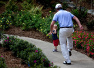 Sports POY: Runner UpJerry Wolford, News-RecordGolfer Webb Simpson chases his son, James Simpson, age 18 months, up the sidewalk after finishing his third round.