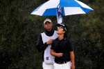 Sports POY: Runner UpJerry Wolford, News-RecordRichard H. Lee is pelted by the rain before he putts on the ninth hole moments before play was halted due to inclement weather during the final round.