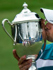 Sports POY: Runner UpJerry Wolford, News-RecordSergio Garcia, of Spain, kisses the Sam Snead Cup (winner's trophy) on the 18th green after winning the rain delayed Wyndham Championship at Sedgefield Country Club.