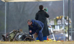 First Place | Spot NewsScott Muthersbaugh, Burlington Times-NewsOfficials, including representatives from the National Transportation Safety Board, the Burlington Police Department and LabCorp, examine the wreckage of a single-engine plane that crashed into an empty field at the Mayco Bigelow Community Center on Sharpe Road in Burlington. The crash killed the pilot, David Gamble, 57, of Greensboro.