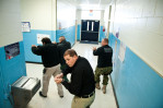 Second Place | General  NewsAndrew Craft, The Fayetteville ObserverRobeson County Sheriff deputies, Hubert Graham, left to right, Adam Chavis, Brandon Patterson and Nakiea Wearins, go through a practice lockdown and sweep of Parkton Elementary School. They pretended to be holding guns instead of actually holding guns because school was in session.