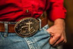 Second Place | Multiple PhotosJames Nix, Independent TribunePastor Jeff Smith's belt buckle at the Cowboy Church Central Station service on December 6, 2013.