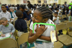 Second Place | General  NewsTodd Sumlin, The Charlotte ObserverFirst-grader Tamia Baldwin hugs her new laptop computer at Druid Hills Academy Tuesday, February 26, 2013.  More than 2,000 laptops were give to first through fourth grade students in the Project L.I.F.T. zone.