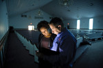 Honorable Mention I General NewsJames Robinson, The Fayetteville ObserverSpring Lake Fire Department Assistant Chief Jason Williams shows Natasha Boykin what he will be checking on his iPad during a follow up inspection at Williams Chapel Church Tuesday morning.
