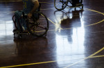 First Place | Multiple PhotosMelissa Melvin-Rodriguez, The Fayetteville ObserverA shadow is reflected on the gym floor during a game between the Fayetteville Flyers and Triad Trackers, competitive wheelchair basketball teams, at Massey Hill Classical High School.