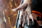 First Place | Multiple PhotosMelissa Melvin-Rodriguez, The Fayetteville ObserverRon Smith's hand is covered in dirt and grit after a basketball game with the Fayetteville Flyers, a competitive  wheelchair basketball team.