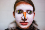 Second Place | Multiple PhotosCristina Fletes-Boutté, Durham HeraldSeventh grader Hadden LaGarde shows off her makeup for playing the part of the eagle in the Carolina Friends Middle School production of Narnia.