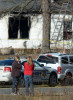 Third Place | Spot NewsScott Muthersbaugh, Burlington Times-NewsA bystander cries in front of 5913 NC 61 north in Gibsonville, N.C. where a one year old girl and a four year old boy died in a blaze on the morning of Saturday, March 9, 2013.
