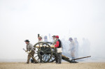 Second Place | Multiple PhotosMelissa Melvin-Rodriguez, The Fayetteville Observer(Left to right) Wade Rogers, Dwight Lovick, Paul McCurley and Bailey Thomas fire a 6-pound bronze canon with the Starrs Battery during an artillery demonstration at Bentonville's 148th anniversary program, {quote}One Continuous Fire of Destruction{quote} at the Bentonville Battlefield State Historic Site. The name of the program comes from a description of the battle by a Union soldier, and focuses on artillery's contributions to the battle.