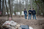 Second Place | Multiple PhotosMelissa Melvin-Rodriguez, The Fayetteville ObserverDave Thomas, foreground, with the Confederacy, laughs as men dressed as Union soldiers stop to talk during downtime at  Bentonville's 148th anniversary program, {quote}One Continuous Fire of Destruction{quote} at the Bentonville Battlefield State Historic Site.